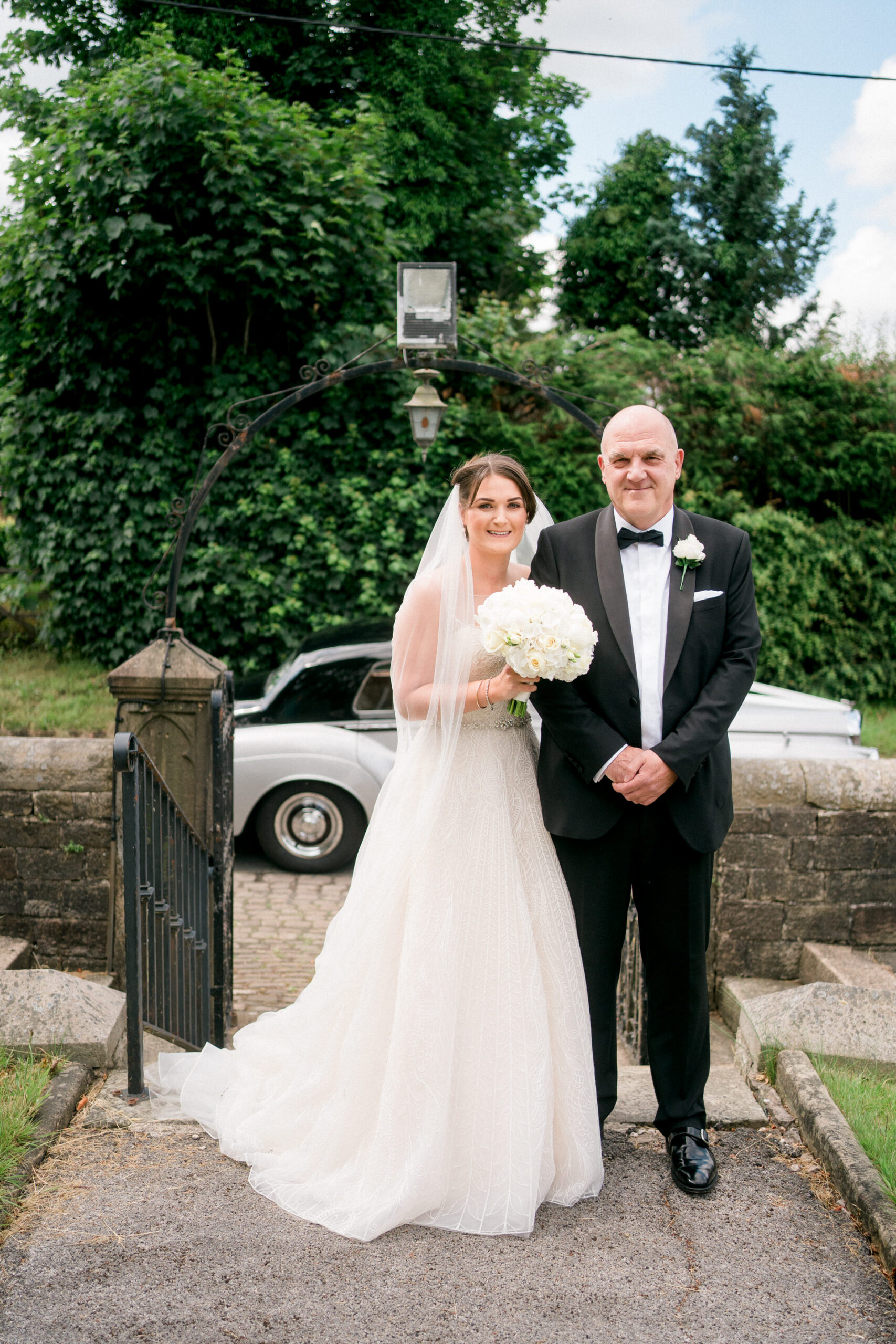 bride and her dad outside mawdesley church