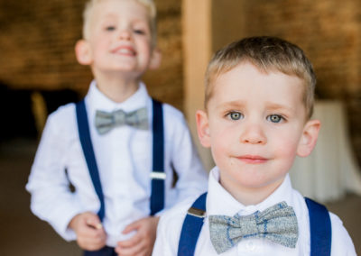 pageboys smile for camera