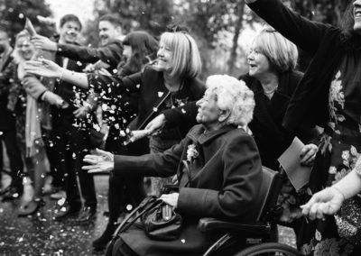 granny in wheelchair throws confetti