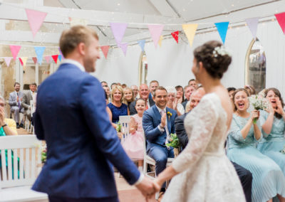 guests cheer newly married couple at wyresdale wedding barn