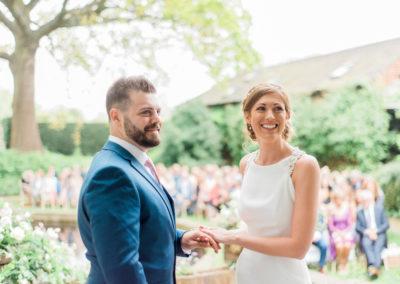 exchanging wedding rings outdoorsoutdoor wedding ceremony