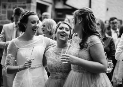 bride and best friends sing to live music