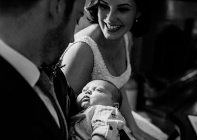 bride and groom with tiny baby