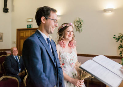 bride with pink hair and her groom at Ely registry office wedding