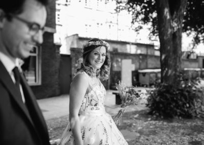 bride with curly hair and floral dress
