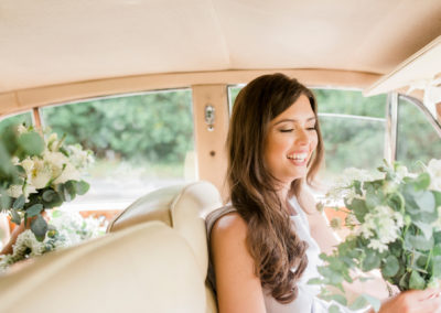 bridesmaid rides shotgun in wedding car
