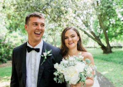 bride and groom laughing in lowther gardens