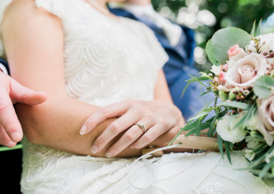 brides wedding and engagement rings on finger