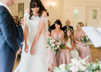 bridesmaids watch wedding ceremony at eaves hall