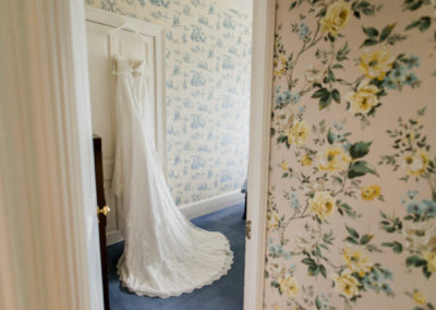 wedding dress and floral wallpaper