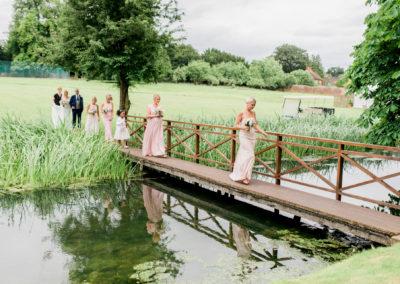 bridesmaids walk over bridge
