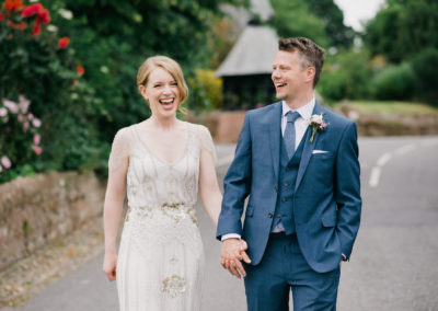bride and groom at Eccleston Village hall laughing