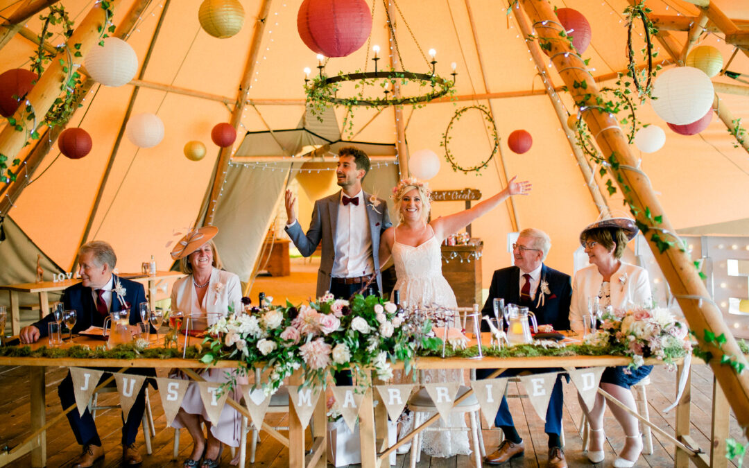 A Bridge House Barn Tipi wedding with a Kenyan Theme